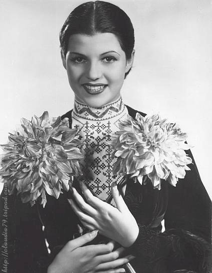 Publicity shot for Paddy O'Day, Rita with the 'Rita Cansino' dahlias